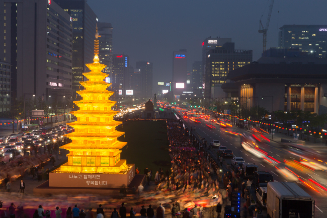 An oversized lantern resembling the stone pagoda of Mireuksa Temple is lit in Gwanghwamun Square in central Seoul.