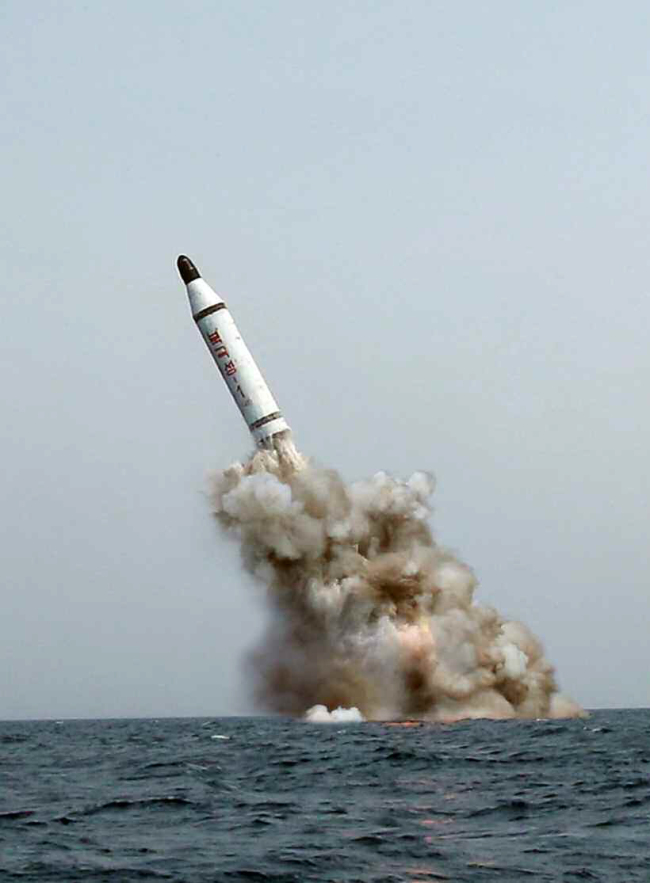 A ballistic missile, called Bukkeuksong, is shown being test-launched from underwater in a photo from a report by North Korea's Rodong Sinmun on Saturday. (Yonhap)