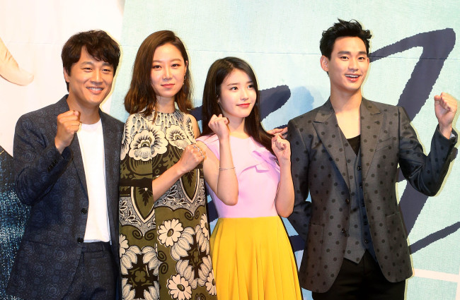 """Cast members Cha Tae-hyun (from left), Gong Hyo-jin, IU and Kim Soo-hyun of """"The Producers"""" pose during a press conference in Seoul on Monday. (Yonhap)"""