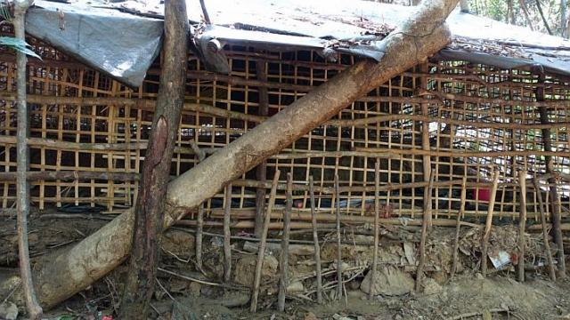 A bamboo prison and a child's shirt found at the abandoned human traffickers' camp near Ban Taloh village in Padang Besar. When security officers entered the camp, they found shallow graves containing at least 26 bodies. (The Straits Times)