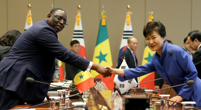 President Park Geun Hye And Her Senegalese Counterpart Macky Sall Shake Hands At A Summit At Cheong Wa Dae On Thursday Yonhap