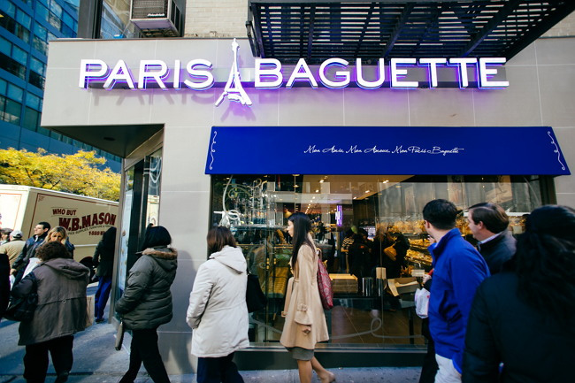 People pass bya Paris Baguette store in New York. (SPC Group)
