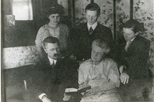 Hulbert's firstborn daughter (left), older son (center) and younger son (right), with a Korean folding screen in the background.