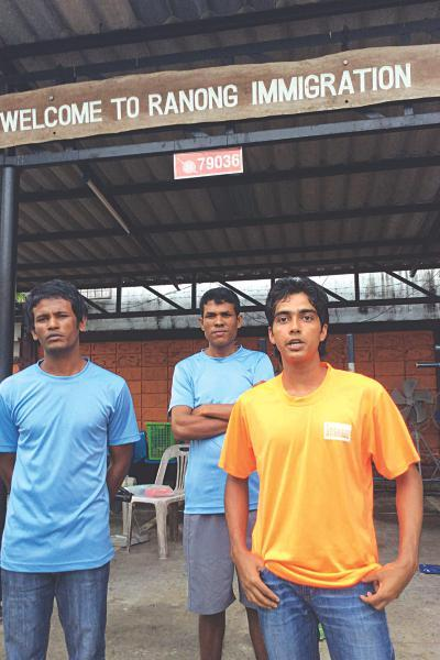 From left: Bangladeshis Shahbuddin, Noor-e-Alam and Nur Alam at the Ranong Immigration Detention Center. (The Daily Star)