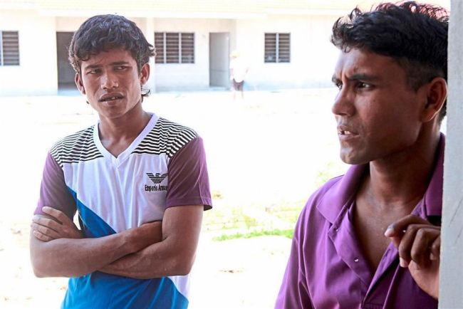 Mohamed Alam (right) and Sonso speak during an interview at their living quarters in Kangar. (The Star)