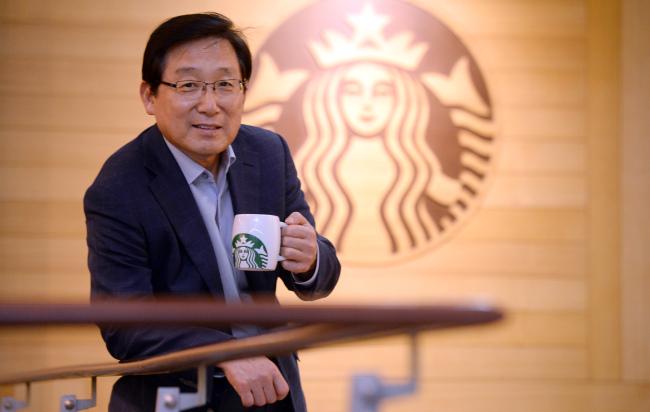 Starbucks Coffee Korea CEO Lee Seock-koo poses at his company in Seoul. (Ahn Hoon/The Korea Herald)