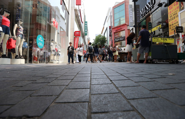 Myeong-dong, a popular tourist destination in Seoul, is quieter than usual Sunday. (Yonhap)