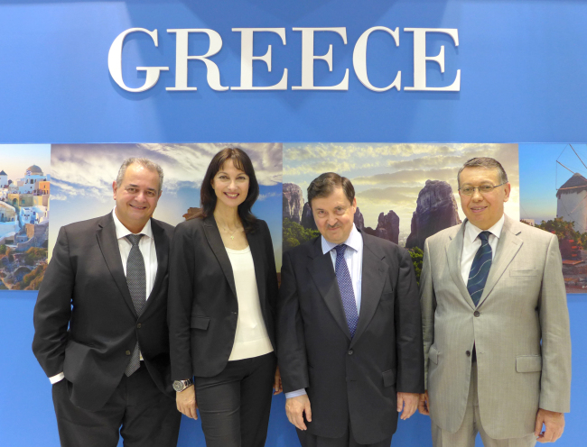 (From left) The general secretary of the Greek National Tourism Organization Panos Liuadas, Greek tourism minister Elena Kountoura, Greek Ambassador Dionisios Sourvanos and the embassy minister counsellor Athanassios Karapetsas pose in front of a national booth at the 2015 Korea Travel Fair at Coex in Seoul on June 12. (Joel Lee/The Korea Herald)