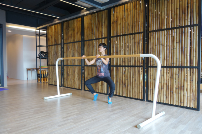 Coach Yoon Seung-hye performs Pilallet, a hybrid exercise that fuses Pilates with ballet. (Rumy Doo/The Korea Herald)