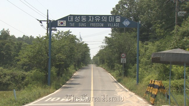 A sign points to the entrance of Daeseong-dong, the only civilian residential area within the southern part of the Demilitarized Zone. Yonhap