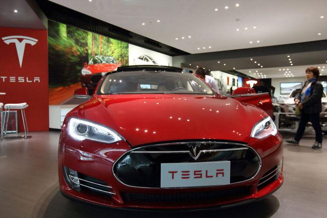 A Tesla Model S sedan sits at a dealership in Beijing. Bloomberg