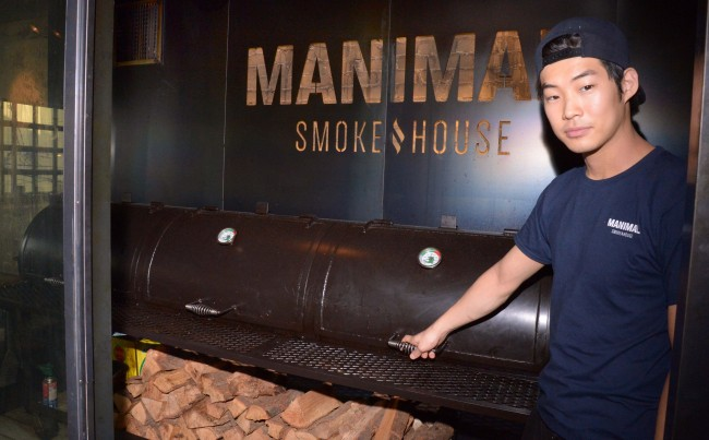 Manimal Smokehouse's wood-fired offset smoker wher cured hunks of pork and beef are barbecued for an average 15 hours a day (Chung Hee-cho/The Korea Herald)