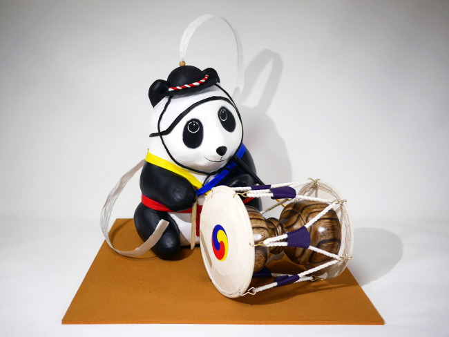 """WWF Korea offers Korean supporters of art and nature an opportunity to adopt 14 special edition pandas of the """"1600 Pandas+ World Tour,"""" created in collaboration with French handcrafted papier-mâché artist Paulo Grangeon, Korean calligrapher Kang Byung-in, and installation artist Rho Dongsik. (AMHERST)"""