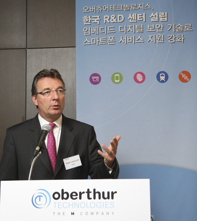 Oberthur Technologies chief executive Didier Lamouche speaks of the firm's mobile security solutions at a press meeting in Seoul on Thursday. Oberthur Technologies