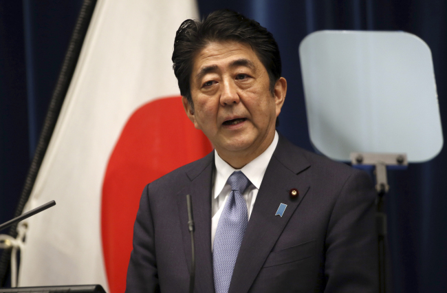 Japanese Prime Minister Shinzo Abe delivers a statement to mark the 70th anniversary of the end of World War II during a press conference at his official residence in Tokyo Friday. (Yonhap)