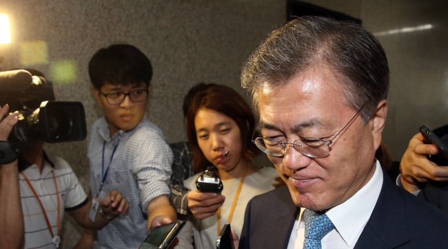 NPAD chairman Rep. Moon Jae-in leaves his office at the National Assembly on Monday. Yonhap