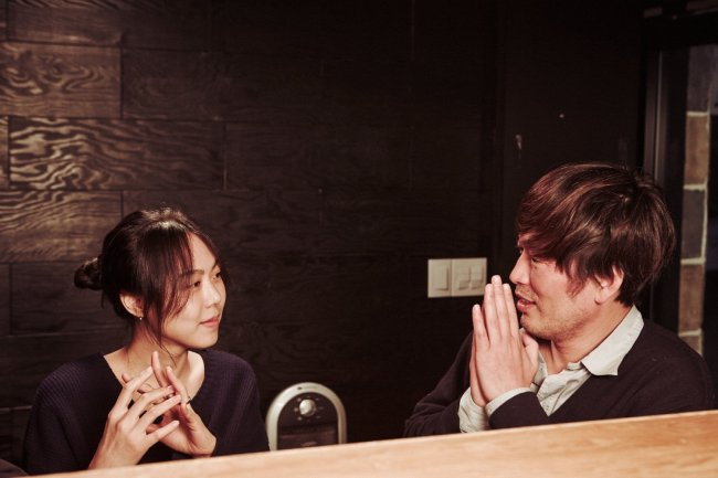 Kim Min-hee (left) as amateur artist Yoon Hee-jung and Jung Jae-young as film director Ham Chun-soo in