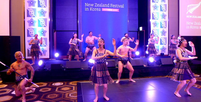 """A 12-person Maori kappa haka group from Christchurch ― """"Nga Manu a Tane"""" ― performs traditional songs and dance at a reception at Conrad Hotel in Seoul on Thursday. Joel Lee / The Korea Herald"""