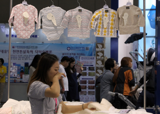 A woman browses baby products at a mall. (Yonhap)