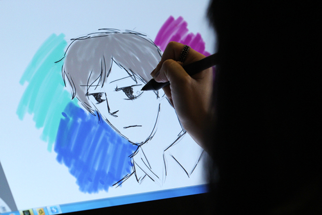 Participants draw webtoons at an event in Seoul. (National Library of Korea)