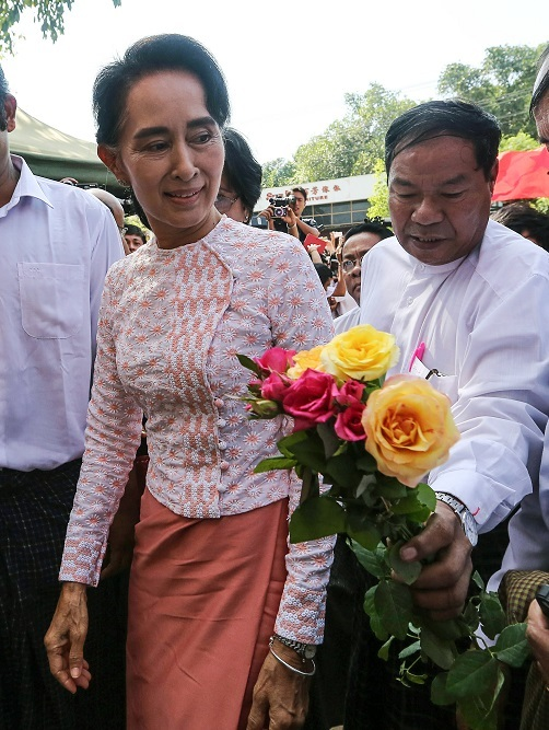 Aung San Suu Kyi, Myanmar`s opposition leader and chairperson of the National League for Democracy, arrives at the party headquarters in Yangon, Myanmar, Monday. (Bloomberg)