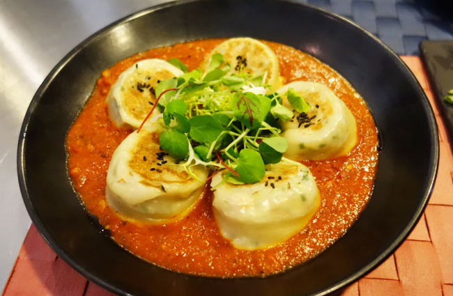 Dumplings filled with trout and soaked in a tomato cream sauce (Rumy Doo/The Korea Herald)