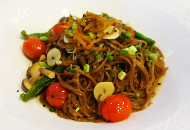 Pasta made with buckwheat noodles, tomatoes, peppers, garlic and an oil-based sauce infused with fish and soy sauce (Rumy Doo/The Korea Herald)