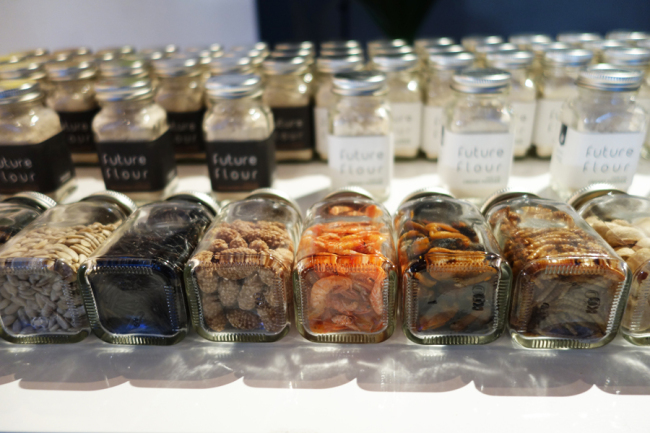 Bottles filled with different types of dried insects at UZU's exhibition at the Dongdaemun Design Plaza, open until Nov. 29 (Rumy Doo/The Korea Herald)