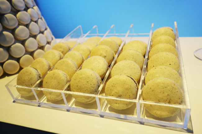 A display of macaroons made with black sesame seed and ground grasshopper (Rumy Doo/The Korea Herald)