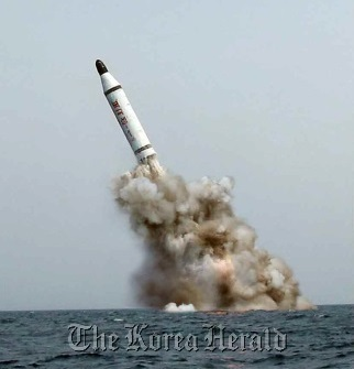 An image published in North Korea's Rodong Sinmun newspaper on May 9 shows a ballistic missile believed to have been launched from underwater. (Yonhap)