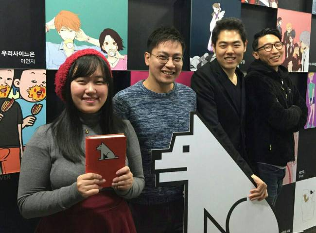 Lezhin Entertainment's U.S. team members – (from left) Grace Chong, Jeon Jae-heung, James Kim and Bae Soon-yong -- pose for a photo at the webtoon platform's headquarters in southern Seoul. Lezhin plans to launch its U.S. service early next year. (Lezhin)