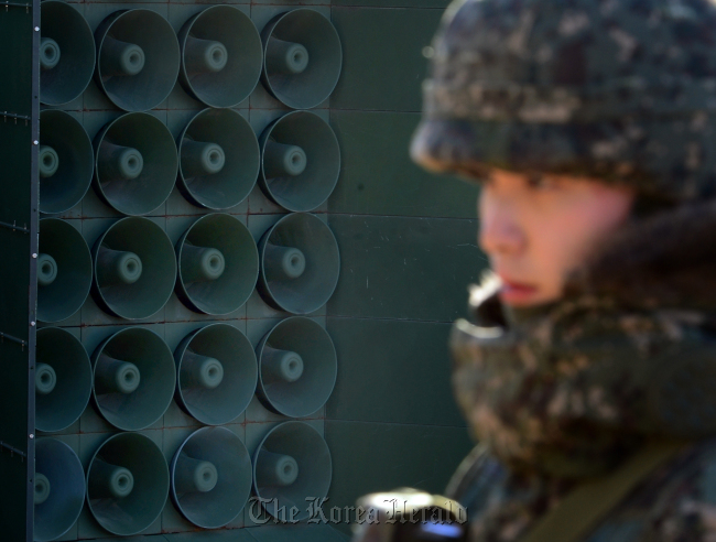A solder is on the guard nearby a set of loudspeakers reactivated Friday in central Gyeonggi Province. (Joint Press Corps)