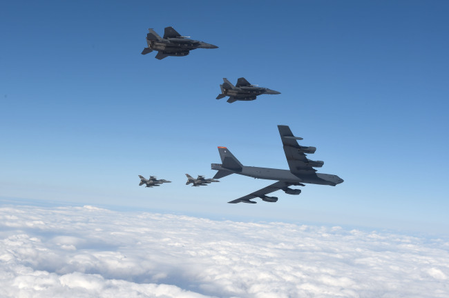 The U.S. B-52 strategic bomber, escorted by four fighter jets, is seen flying over the Korean Peninsula on Sunday. (Yonhap)