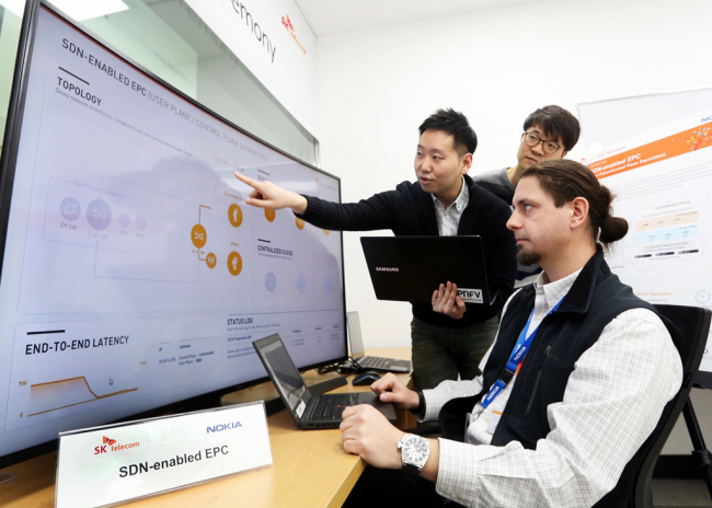 Staffers from SK Telecom and Nokia Networks monitor the wired 5G technology at the 5G Global Innovation Center in Bundang, Gyeonggi Province, on Monday. (SKT)