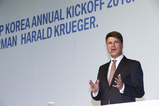 BMW Group chairman Harald Krueger makes a speech during the annual kick-off meeting of BMW Korea on Monday. BMW Korea