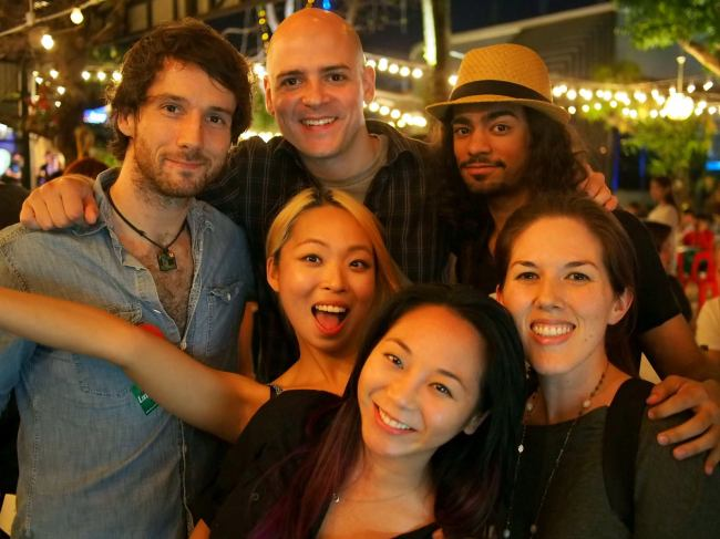 Do You-jin (center) poses with digital nomads in Thailand. (Do You-jin)