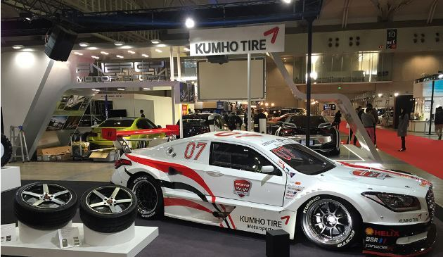 The booth of Kumho Tire at Tokyo Auto Salon 2016 displays a car fitted with the firm's high-performance tires and various tire solutions. (Kumho Tire)