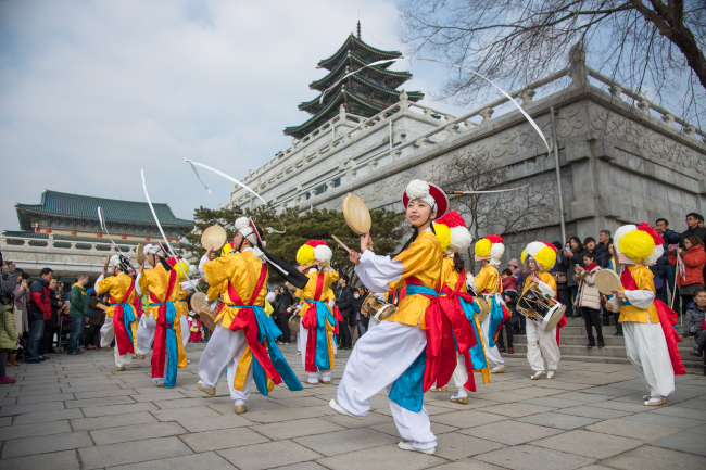 Performers play traditional Korean music instruments in the front courtyard of the National Folk Museum of Korea in Seoul. (The National Folk Museum of Korea)