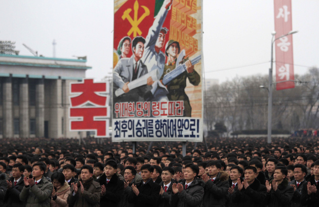 North Koreans gather at the Kim Il-sung Square to celebrate a satellite launch held on Monday. (AP/Yonhap)