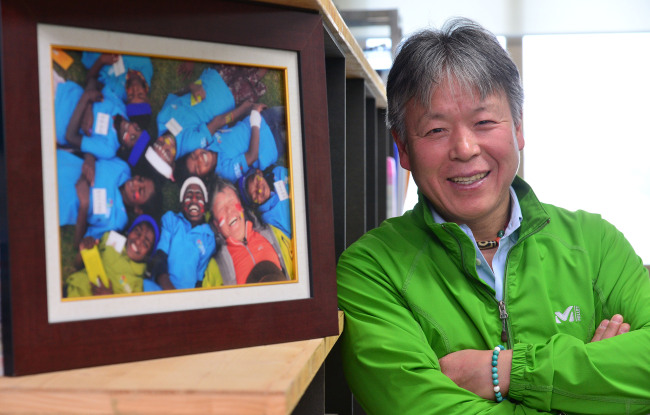 Mountaineer Um Hong-gil poses at the office of the Um Hong-gil Human Foundation in Jung-gu, Seoul. (Lee Sang-seob/The Korea Herald)