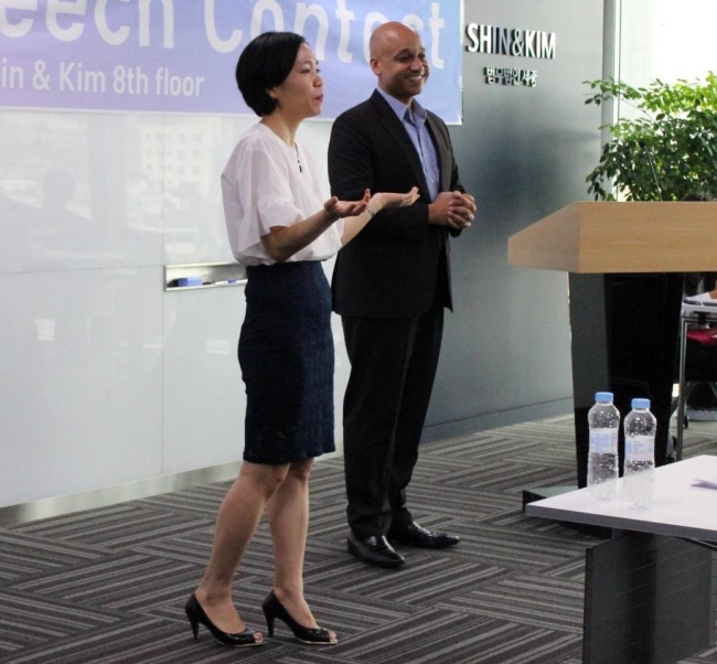 Casey Lartigue and Lee Eun-koo, cofounders and codirectors of Teach North Korean Refugees, speak at TNKR's English speech contest last year. (TNKR)
