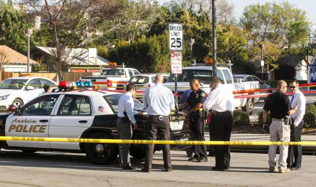 Police officers investigate the scene near Pearson Park in Anaheim, California, on Feb. 27 after three counter-protesters were stabbed while clashing with Ku Klux Klan members staging a rally. Thirteen people were arrested.AFP