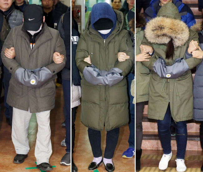 A 47-year-old pastor (left) and stepmother (center) are taken into custody for beating their 13-year-old daughter to death and hiding the body for 11 months in Bucheon, Gyeonggi Province, on Feb. 4. The deceased girl's aunt (right) is also charged with abusing the child. (Yonhap)