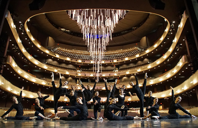 Shen Yun dancers pose on stage before a show at the AT&T Performing Arts Center in Dallas, Texas. (Shen Yun Performing Arts)