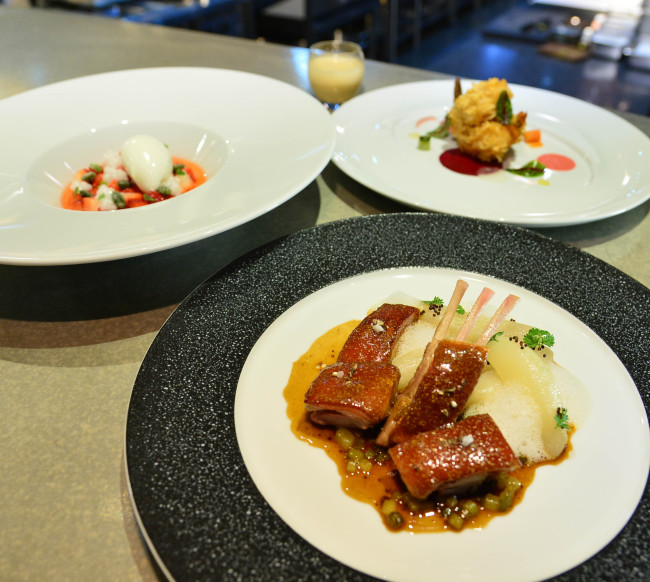 Exquis' honeyed suckling pig with pear (front), shrimp croustillant with sweet and sour vegetables (back, right) and strawberries with fromage blanc ice cream and tapioca (back, left) (Photo credit: Yoon Byung-chan/The Korea Herald)