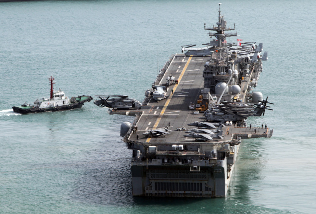 The USS Bonhomme Richard leaves a naval base in Busan on Monday to join Korea-U.S. joint exercises. (Yonhap)