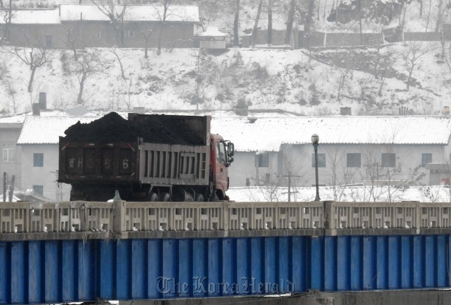 A coal truck is headed to Namyang, North Korea, after departing from the Chinese border town of Tumen on March 4. (Yonhap)