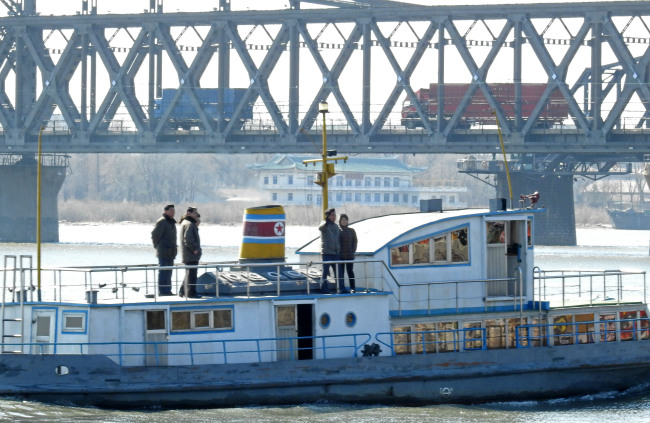 North Korean citizens sail on a boat on Amnok River, which shares a border with China, on Tuesday. (Yonhap)