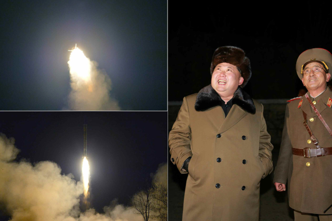 In this image carried Friday by the Rodong Shinmun, North Korean leader Kim Jong-un (left) observes the test launch of short-range missiles on Thursday. (Yonhap)