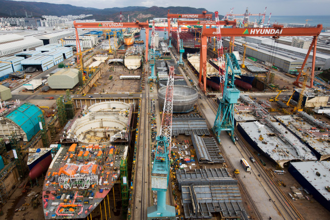 Ships stand under construction in the dry dock at the Hyundai Heavy Industries shipyard in Ulsan, Korea. (Bloomberg)